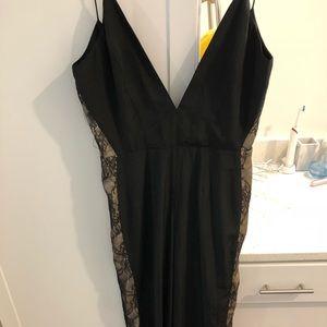 NBD black jumpsuit with lace side trim